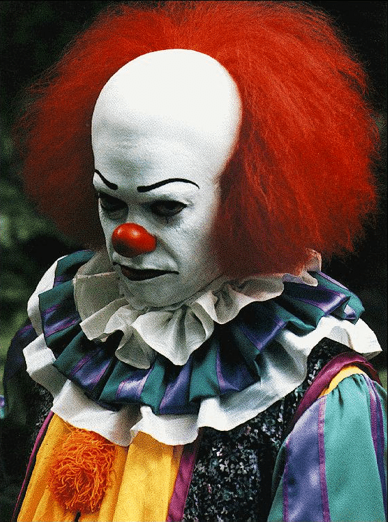 Tim Curry as Pennywise the Clown, aka nightmare fuel to 80's/90's kids.