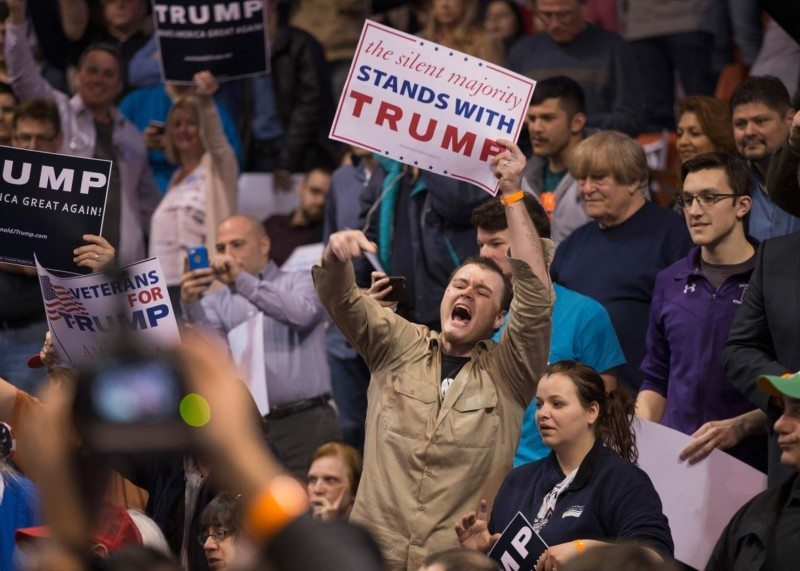 A Donald Trump supporter heckles demonstrators before a scheduled rally at the University of Illinois at Chicago on March 11 in Chicago.
