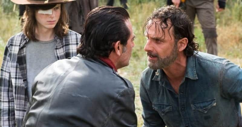 Negan (right) faces off with Rick (left) in THE WALKING DEAD TV guide