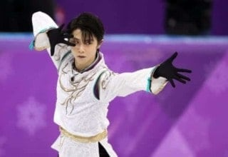 Yuzuru Hanyu is posing during one of his routines at the Olympics