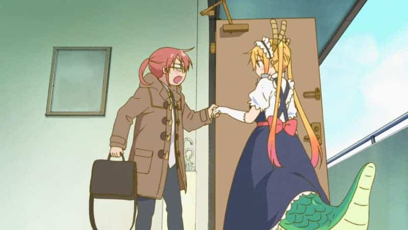 Kobayashi grabs Tohru's hand as she walks out the door. MISS KOBAYASHI'S DRAGON MAID earned Best Comedy at the Crunchyroll Anime Awards