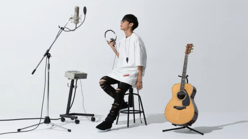 This album cover features Masayoshi sitting on a stool next to a guitar and a microphone.