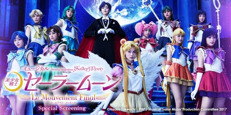 An actor dressed as Sailor Moon stands toward the front of the image with actors dressed as the other main characters of the series behind her.