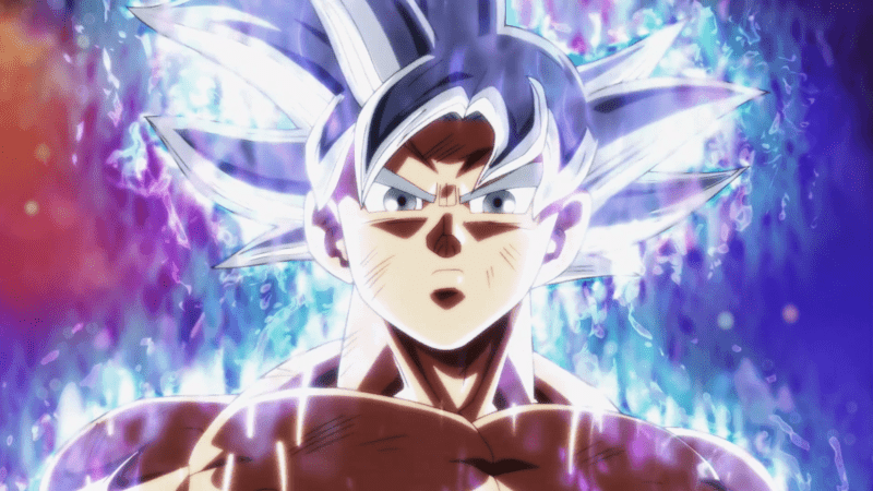 Goku stares with glowing white hair and eyes.