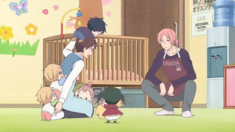Five of the babies crowd around Ryuichi while Yoshihito watches.