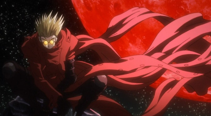 Vash is back lit by the blood moon