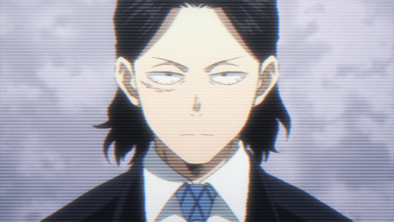 In a rare moment in MY HERO ACADEMIA, Eraser Head appears at a news briefing in a suit.