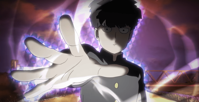 A powerful aura emanates from Mob as he prepares to use his psychic abilities with his hand outstretched.
