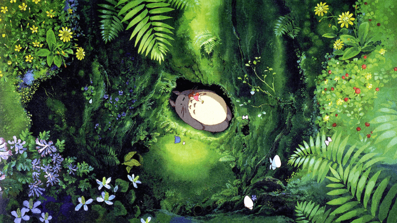 Mei on Totoro's stomach in the roots of the big tree in MY NEIGHBOR TOTORO.