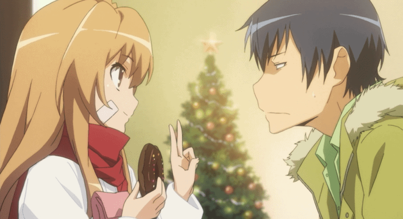 Taiga and Ryuji chatting on a busy holiday street.