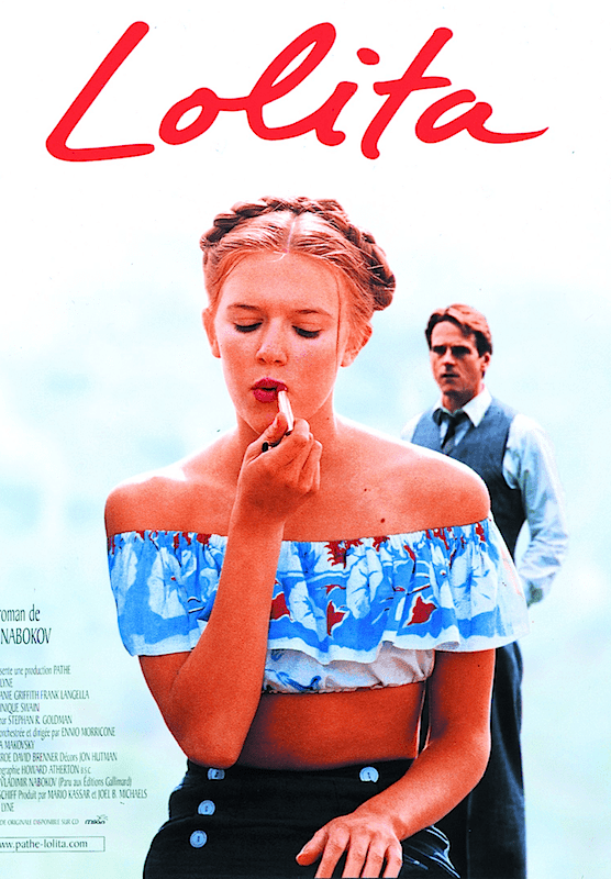 A poster from the 1997 version of Lolita, featuring its titular character applying lipstick while Humbert stands in the background.