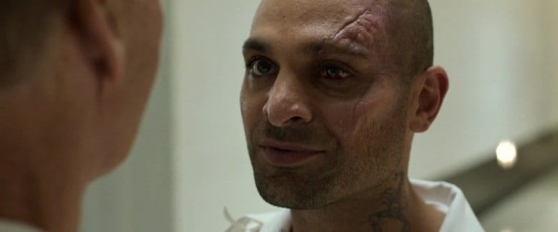 Sinister Six Marvel: Mac Gargan in prison with a scorpion tattoo