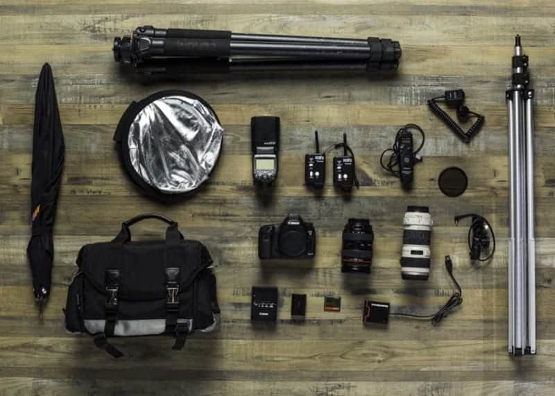 The contents of a photography kit laid out on the floor